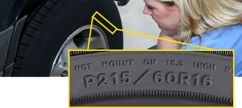 Woman viewing tire sidewall focused on tire size P215/60R16